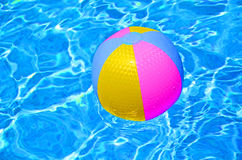 Multicolored Beach ball in swimming pool Stock Images
