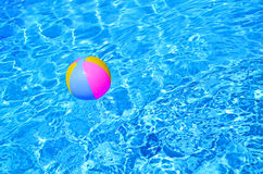 Multicolored Beach ball in swimming pool Stock Photo