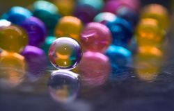 Multicolored beads absorb water. Abstract background. Multicolored beads absorb water. Abstract background stock photos