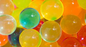 Multicolored beads absorb water. Abstract background. Royalty Free Stock Photo