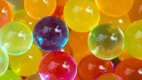 Multicolored beads absorb water. Abstract background. Stock Photography