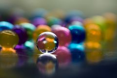 Multicolored beads absorb water. Abstract background. Multicolored beads absorb water. Abstract background stock photography