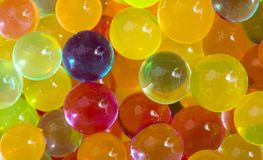Multicolored beads absorb water. Abstract background. Multicolored beads absorb water. Abstract background stock photo