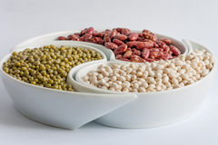 Multicolored beans in ceramics bowl. Different types of Multicolored beans in white ceramics bowl Royalty Free Stock Photography