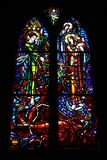 Multicolored beautiful stained glass windows in the main gothic cathedral of France stock images