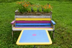 Multicolored bench and table in a garden of Engelberg Royalty Free Stock Photography