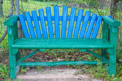 Multicolored bench. Multicolored wood bench in the park stock photos