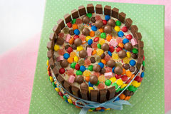 Multicolored birthday Pinata cake stuffed with sweets. Inside Stock Photos