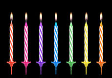 Multicolored birthdays candles isolated on black background Stock Photo