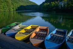 Multicolored boats on lake Royalty Free Stock Photography