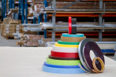 Multicolored bobbins of PVC edge and melanin for the manufacture of furniture. Lie pyramid. Royalty Free Stock Photography