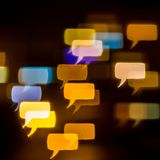 Multicolored bokeh of lights in form of a dialog sign on defocus Stock Photo