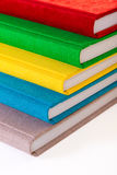 Multicolored book textile cover. Photobooks on a white background. Stock Image
