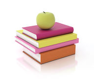 Multicolored book tower with green apple on the top, isolated on white background Royalty Free Stock Photo