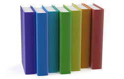 Multicolored books in row. Isolated on white background Royalty Free Stock Photos