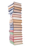 Multicolored books stack isolated on white background. Royalty Free Stock Images