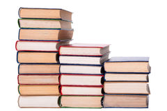 Multicolored books stack isolated on white background. Stock Images
