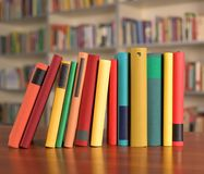 Multicolored books are on the table. In library Royalty Free Stock Photography