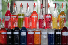 Multicolored bottles of flavored syrup Royalty Free Stock Photography