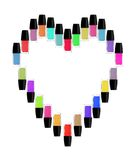 Multicolored bottles of nail polish in the form of heart. Stock Images