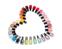 Multicolored Bottles Of Nail Polish In The Form Of Heart Royalty Free Stock Image