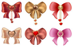 Multicolored bows with hearts and pearl jewelry. Red and gold hearts with vintage ornaments and bows Stock Images
