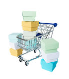 Multicolored boxes in a shopping cart Stock Photography