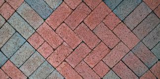 Brick floor mosaic for background or design element. Multicolored brick pattern from tiled urban walkway Stock Images