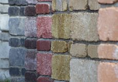 Multicolored bricks. Small walls of multicolored bricks connected  with mortar Stock Photos