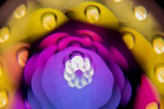 Multicolored bright big bokeh beautifully glow on a black background. Kaleidoscope of energy-saving lamps stock photos