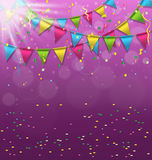 Multicolored bright buntings garlands with confetti and light on Royalty Free Stock Image