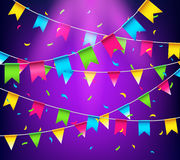 Multicolored bright buntings garlands. Party flags with confetti Royalty Free Stock Photography