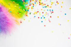 Multicolored bright feathers for the Brazilian carnival. White b. Part of the costume for the Brazilian carnival. Colored bright feathers Royalty Free Stock Photo