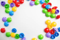 A multicolored bright frame background made of children`s toys. Space for text royalty free stock photo