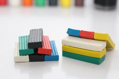 Multicolored bright plasticine on a white background royalty free stock images