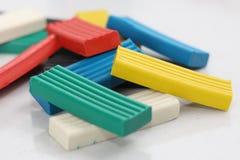 Multicolored bright plasticine on a white background stock image