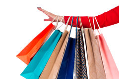 Multicolored and bright shopping packages hanging on female red- Stock Photo