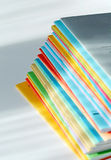 Multicolored brochures Stock Photos