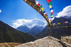 Multicolored Buddhist flags. Himalayan mountains, Nepal. Annapurna circuit. Multicolored Buddhist flags. Himalayan mountains of Nepal. Annapurna circuit trek royalty free stock photography