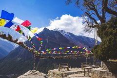 Multicolored Buddhist flags. Himalayan mountains, Nepal. Annapurna circuit. Multicolored Buddhist flags. Himalayan mountains of Nepal. Annapurna circuit trek stock photos