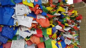 Multicolored buddhist prayer flags flutter in the strong winds.  stock footage