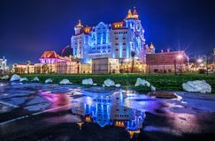 Multicolored building of the Congres. S Center in the Olympic village in Sochi in the night illumination stock photos