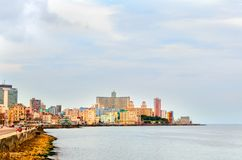 Multicolored buildings of Cuban Havana in the summer noon from t. He side of Malecon Embankment, near the ocean Stock Photos