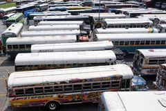 Multicolored buses. Wait in a parking lot Royalty Free Stock Photos