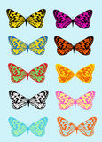 Multicolored butterflies on a blue background Stock Images
