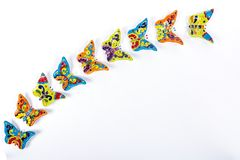 Multicolored butterflies in Mexican ceramics royalty free stock photography