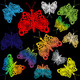 Multicolored butterflies, patterned outline. Multicolored butterflies, a pattern with a pattern on black Stock Photos