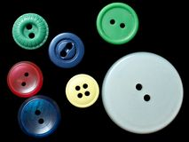 Multicolored buttons. Assorted buttons on black background Stock Image