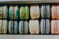 Multicolored cake macaron or macaroon lie in a box, pastel colors almond cookies, close-up.  Stock Photos