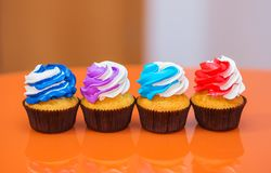 Multicolored cakes on a bright table Royalty Free Stock Photography